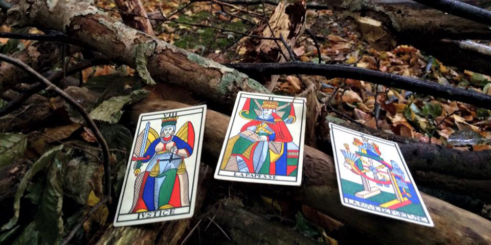 Three tarot cards pictured on the ground