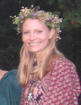 photograph of the author, a blond, caucasian woman, wearing a wreath of flowers