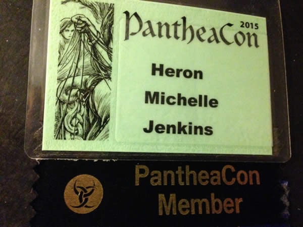 a green, laminated name tag for the author's visit to PantheaCon