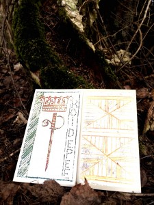 two tarot cards placed on the ground before a tree root