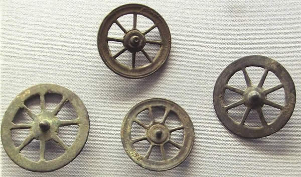 a series of four spoked wheels