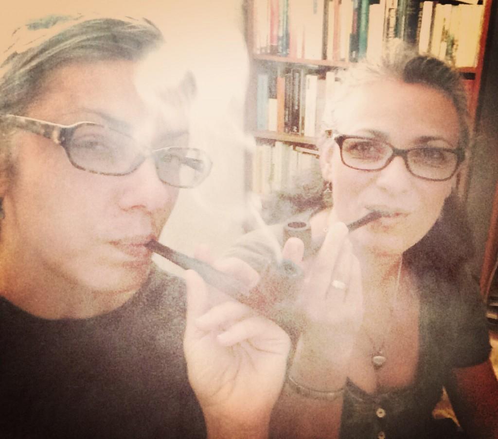 photograph of camelia elias and manna hojda smoking pipes