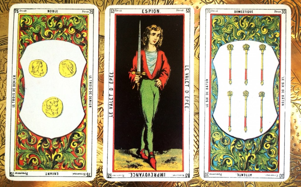 three cards face up -- the outer most cards are blurry but the center, focused card depicts a young woman holding a sword