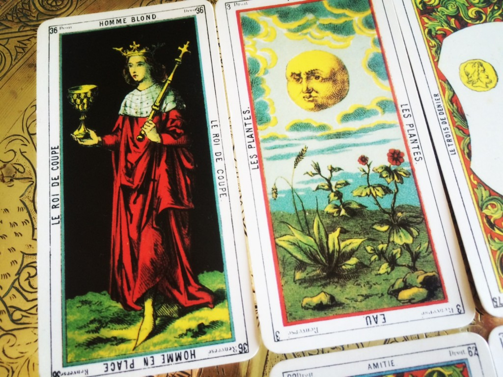a close-up of a tarot spread depicting portions of a number of different cards