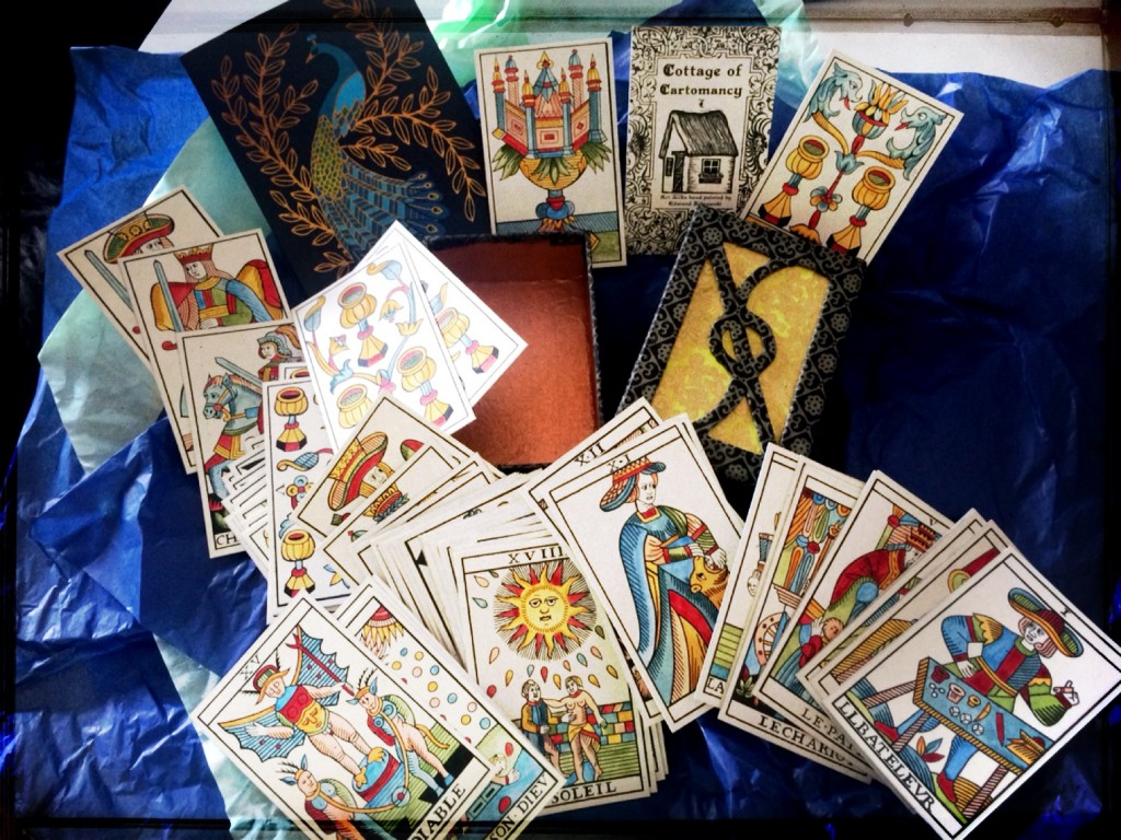 tarot cards poured haphazardly out on a table