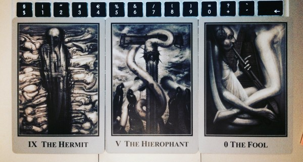 three tarot cards: the hermit, the hierophant, and the fool