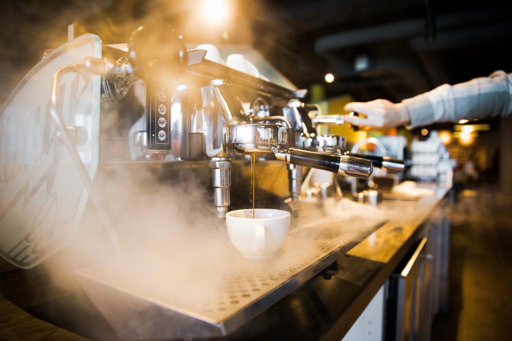 Espresso machine in use.