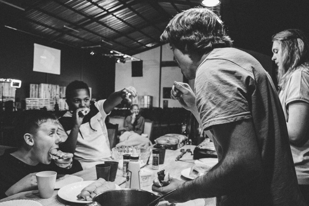 people laughing and sharing a meal together