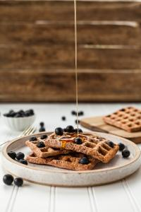 breakfast food: waffles with berries and syrup