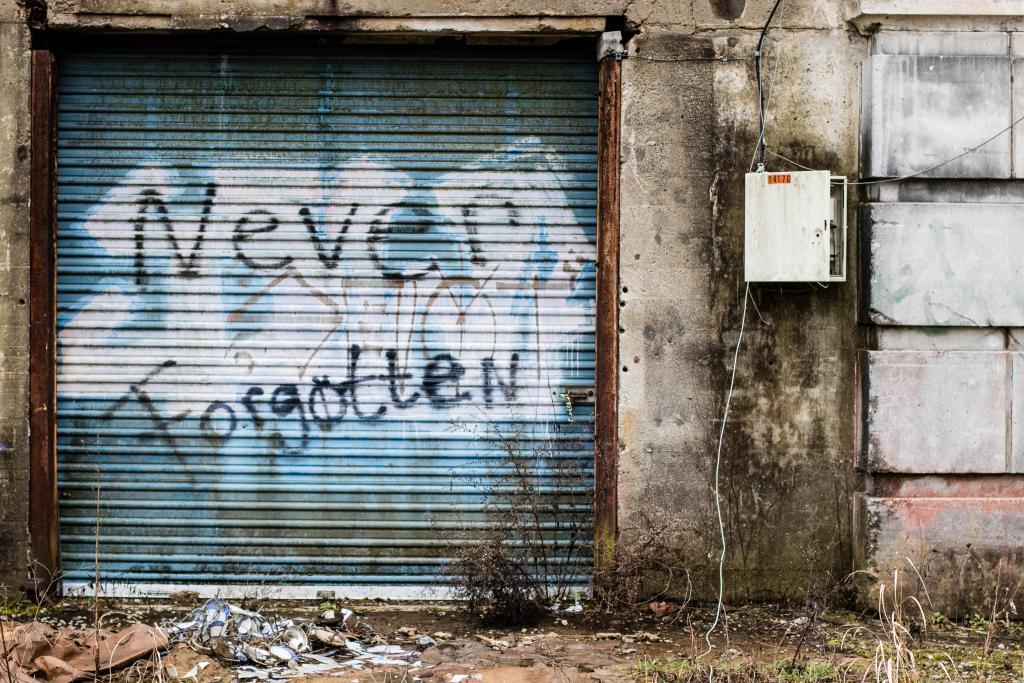 Metal door with graffiti on it.