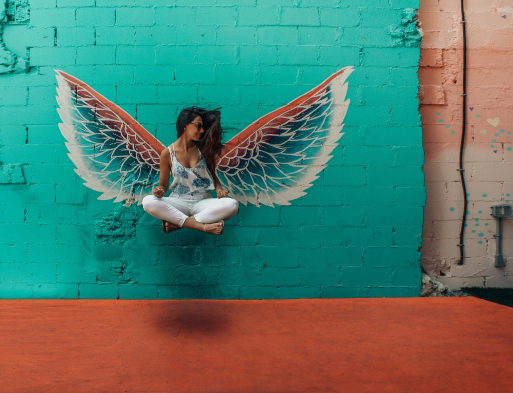 Woman with colorful wings.
