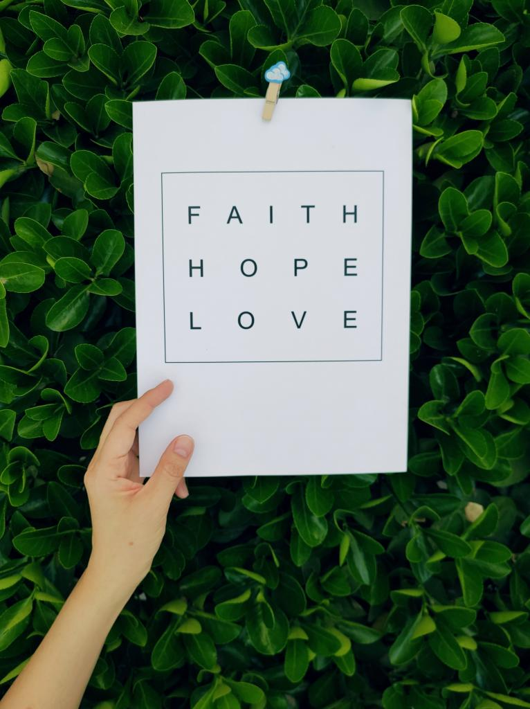 Sign with words, faith, hope, love on it.