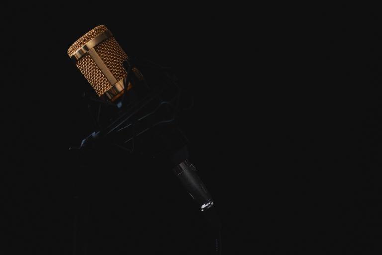 Hrayr Movsisyan, Unsplash.com, CC0 Licensing -- Image of a microphone set against a black background