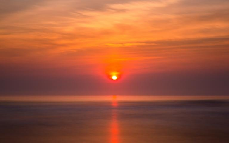 Sunset, in which the sun looks like it's about to crash into a body of water. Dave Hoefler, Unsplash.com, CC0 Licensing