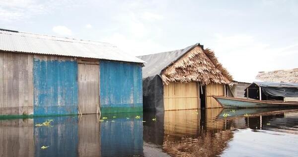 Image of a flooded village in Perú near the Amazon, Deb Dowd, Unsplash.com, CC0 Licensing