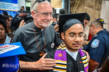 Marco Saavedra, backed by Rev. John Fife, founder of the Sanctuary Movement. Photo by Steve Pavey.