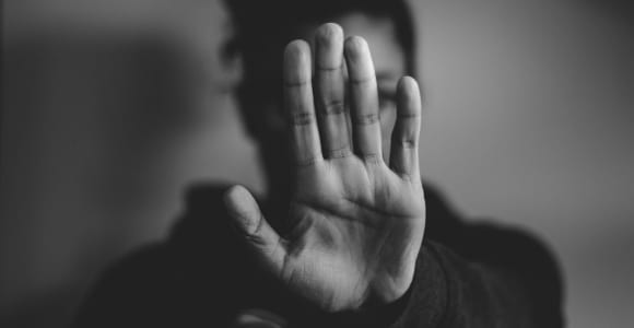 close-up photography of person lifting hand
