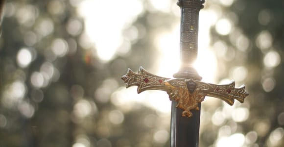 close-up photography of gold-colored and black sword