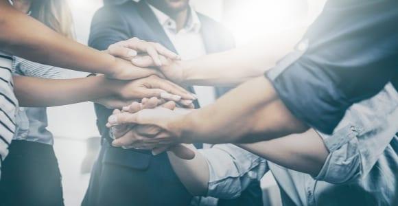 hands together as team