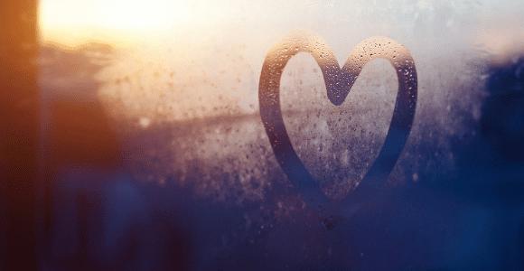 heart drawn in fogged glass