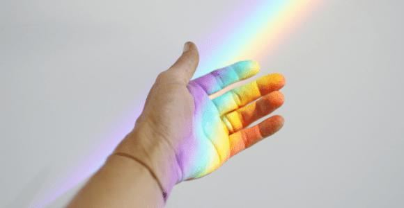rainbow across a hand