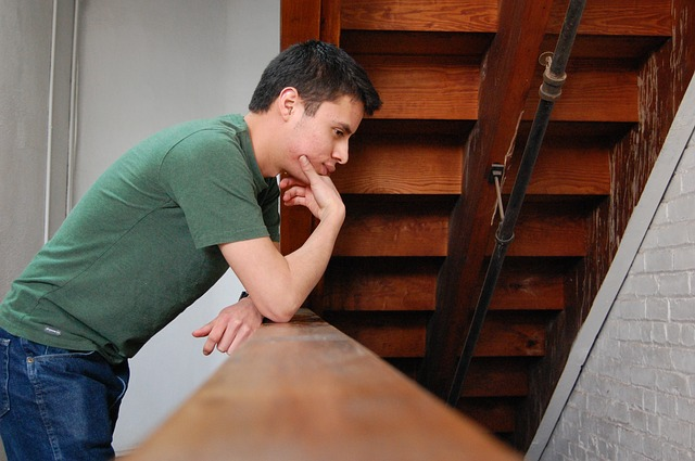 stressed man trying to break free from worry