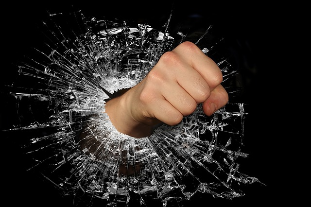 fist punching through glass represents the nastiness on the Internet