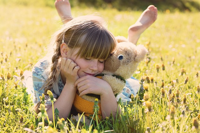 Girl hugging a stuffed bear teaches us the importance of learning to be content