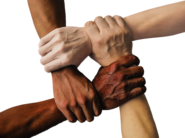 Love one another- four people holding hands