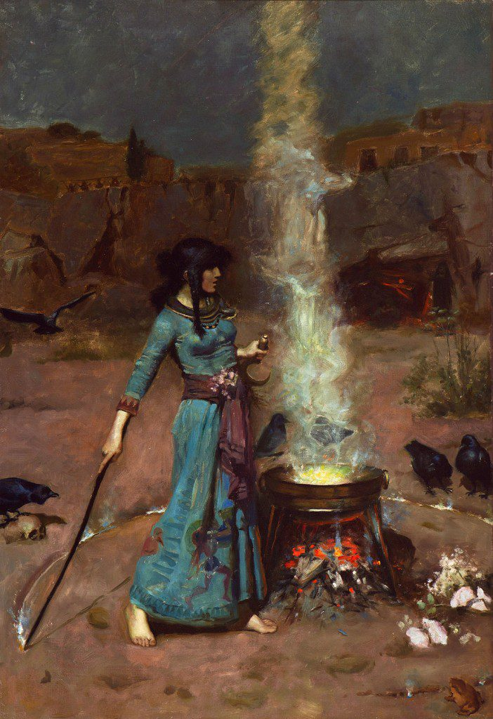 a woman in a blue robe standing before a steaming cauldron