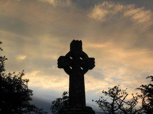 Celtic cross at dawn in Knock, Ireland (at the bus stop to Westport) 28/07/2005 by Sebd. CC license 3.0.