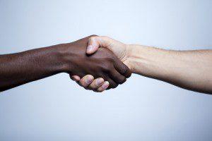 an interracial handshake