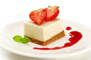 a plate of strawberry cheesecake