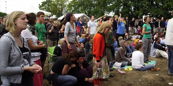 Christians praying and worshiping at a festival. Similar energy, but much less expensive setting then Bethel. Photo by the author.