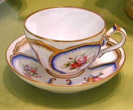 a china tea cup on a saucer