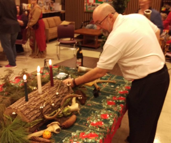 Oengus Sea Eagle, Senior druid of the Sinnisippi Tuath Grove, adjusting our Yule log /  Photo by Kara Sigrun