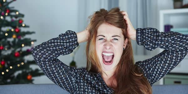 young girl screams because of bad christmas stress