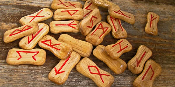 a series of runes on wooden chips
