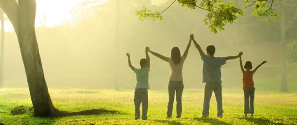 a family in the park during a beautiful sunrise, backlight