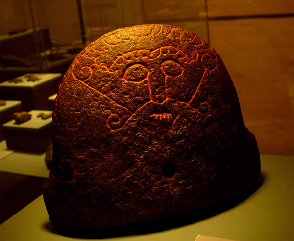 a stone carved with a depiction of Loki