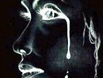 a photo negative image of a woman crying