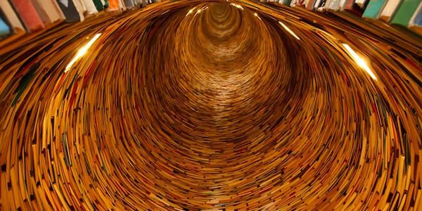 a large number of books arranged in the shape of a tunnel
