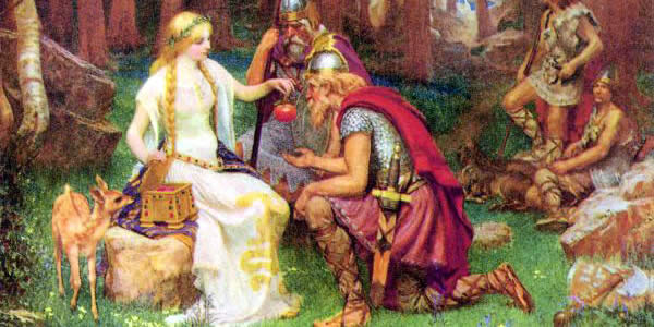 a blond woman hands apples to other men and women in chain mail