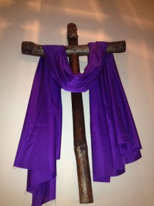 "The purple drap on a cross is related to the idea that in Jesus Christ's day, purple was to be worn by royalty only. This symbol then says, ""Jesus Christ is King of Kings."""
