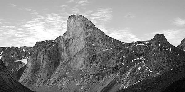 a black and white photo of a cliff face