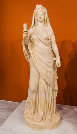 a statue of a goddess wearing robes