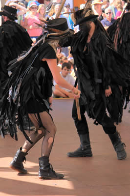two dancers in leather with bells on their feet
