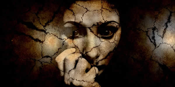 a woman's face digitally altered to appear cracked as if made of glass