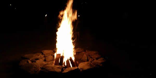 a bonfire inside a ring of stones
