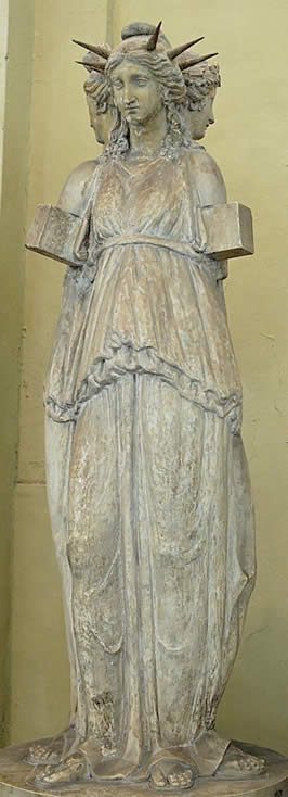 a statue with three faces representing Hecate